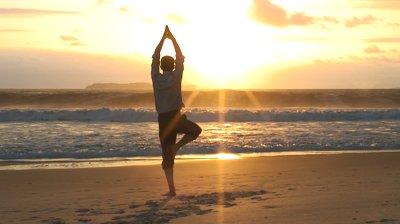 yoga-on-a-beach-at-sunrise